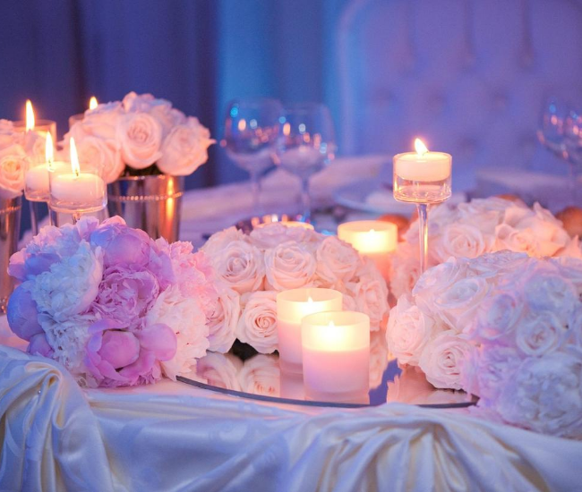 flowers and candles on a white table