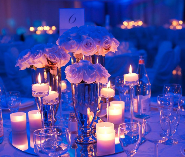 flowers and candles in a blue setting